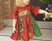 Child's stripwork peasant dress for Christmas. Girls Christmas dress in sizes 6 months, 12 month, 2t, 3t, 4t, 5, 6, 7, and 8.