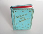 sweet vintage aqua and red address book with gold fleur de lis