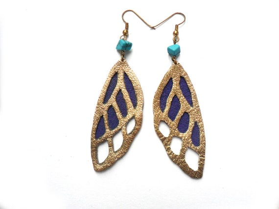 Leather butterfly earrings in bright purple and gold with turquoise beads