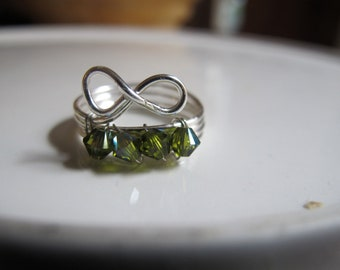 Wire wrapped infinity AUGUST birthstone ring for children with green peridot Swarovski crystals, children's jewelry