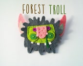 Felt brooch, snotty green troll/monster from the forest.
