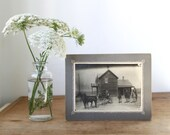 antique photograph. Rural rustic scene. The Nelson Family, Idaho, 1910. Horses and buggy, parents and boys. Wood frame house.