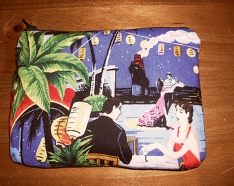 Deco style fabric hand made zipped make up pouch/bag.  Fully lined and padded.