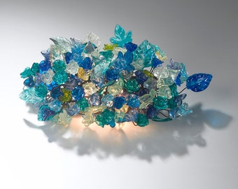 Wall sconce light with sea color flowers -wall light with shades of blue color flowers and leaves.