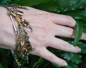steampunk charm bracelet keys and locks copper mixed metals in gypsy boho hippie gothic and belly dancer style