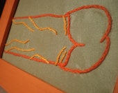 Hand embroidered Penis, 4x6 fabric in orange wood photo frame