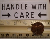"vintage 1955 rubber stamp ""Handle With Care"" used to mark your packages. made  from original plates. vintage wood too."