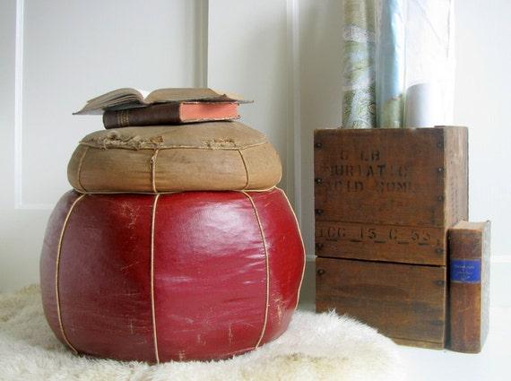 Leather bound straw stuffed Hassock / ottoman
