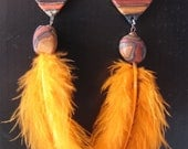 Tribal earrings with orange feather