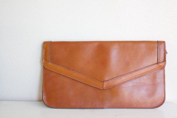 magic leather clutch