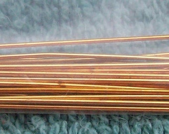 Gold colored eye pins