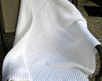 Soft as a cloud knitted crib size cotton baby blanket