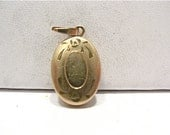 Vintage 14k Gold Filled Locket Small Oval 8 x 12 mm   1.4 grams  #77