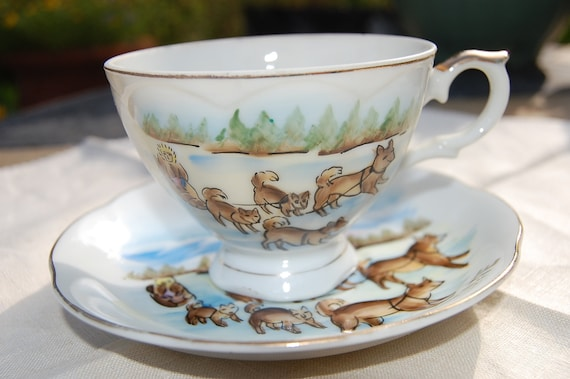 Reserved for Anne Alaska hand painted cup and saucer dog sledding ,49th State , made by Norcrest