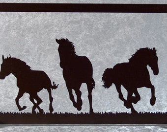 Three galloping horses, table silhouette cut wood