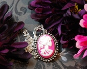 Lady Amaranth, a pink skeleton cameo necklace