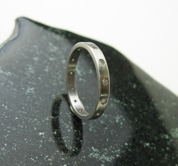 Sold to Byrdclyff  White Gold Ring with 12 Flush Set 1 Point Diamonds, USA ca.1980-1990.