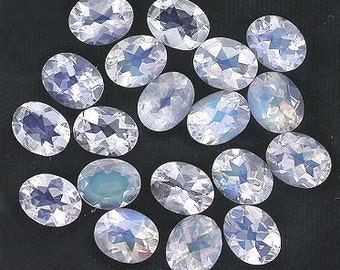 one 5x4 oval faceted rainbow moonstone gemstone gem