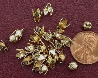 eighteen 5mm  gold plated bell caps