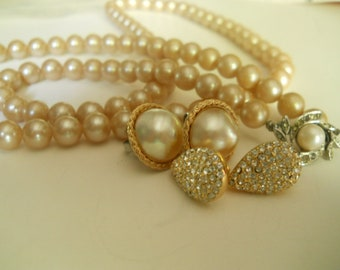 pearls  28 inches long with lovely rhinestone and pearl clasp