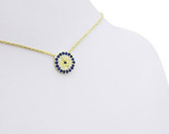 Silver chain necklace with an evil eye charm  (gold color)