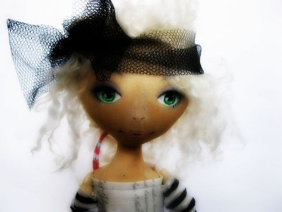 Textile toned doll named Nea. The use of different colors of cotton, textile mesh, face painting acrylics and pastels