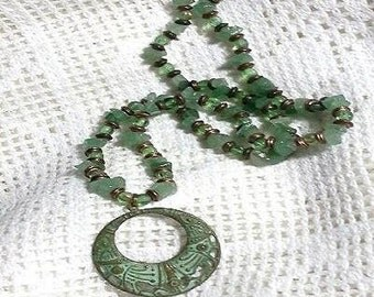 Light Green Fluorite and glass,beaded by hand.