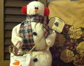 Tall Primitive Snowman with ear muffs and snow bag