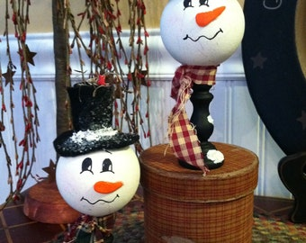 Set of Two Country Snowman or Gingerbread Man on Pedestal.