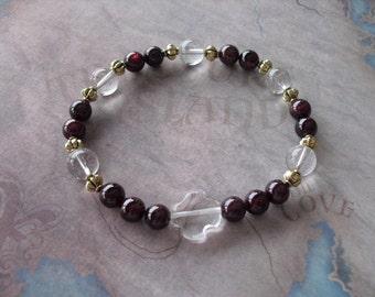 Religious red garnet bracelet