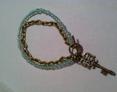 Seafoam and antique gold bracelet