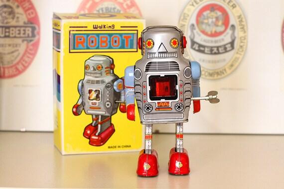 Retro walking robot tin windup toy, chest sparks when he walks