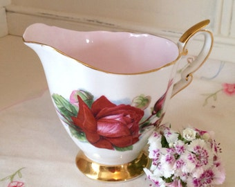 Vintage 1950s Paragon creamer or Milk Jug in the  Harry Wheatcroft Grand Gala roses design with pink interior. MJ003.