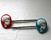 Red and blue skull cameo hair clips