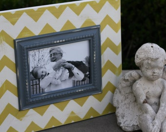 5x7 chevron distressed frame. Colors are mystique (off white) and mustard yellow.  Inner trim is charcoal grey.