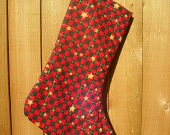 Red and Green Christmas Stocking with gold stars, lined with red fabric