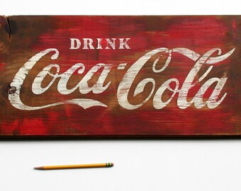 Vintage style CocaCola sign
