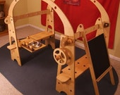 Waldorf Playstands with Kitchen Sink, Stove-top, Steering Wheel, and Chalkboard Easel - Build and change using wooden bolts and nuts.