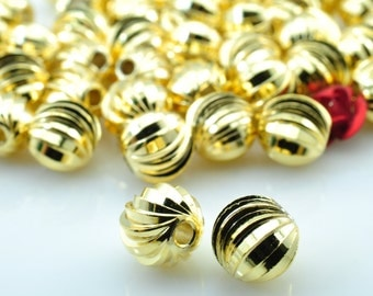 10 pcs of Gold plated Ribbed round  beads  in 8mm