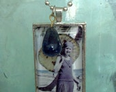 Vintage pic pendant of Gatsby era beauty with parasol