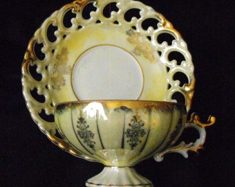 Pastel yellow and gold Cup and Saucer