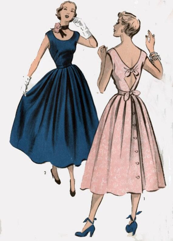 Five 40s Dresses That Capture The Era: Vintage 40s Advance 5497 Swing Era Dress W/ Low SCOOPED