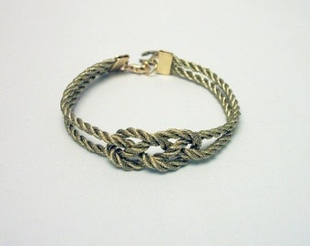 Metallic gold double infinity knot nautical rope bracelet with gold anchor charm