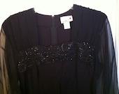 Black vintage beaded dress with sheer sleeves