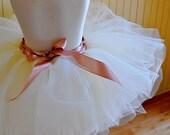 Ivory Flower Girl Tutu with satin ribboned waist. Featured in Martha Stewart Weddings Magazine Spring 2011.