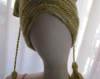 Simple Yellow Ochre beanie with Long Tassels at Corners.