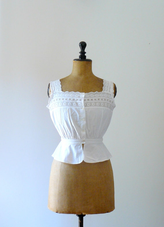 Antique camisole. Vintage 1910 openwork white corset. lingerie