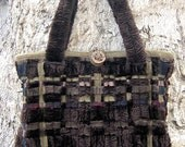 Brown handwoven handbag of ribbons of wool, faux fur, and satin with leather bottom and handmade pine button