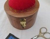 Sewing box with red pincushion, mauve silk interior
