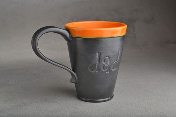 Dad Mug: Gun Metal Black & Orange Stamped Dad Mug by Symmetrical Pottery